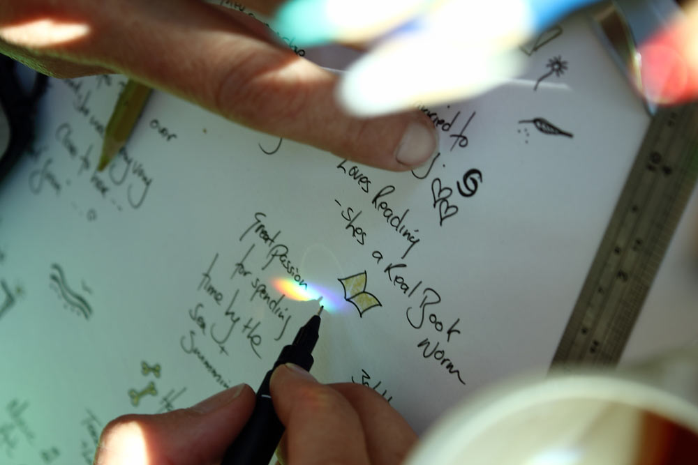 image of Jackie Keilthy taking notes and designing the piece