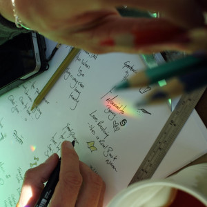 Image of Jackie Keilthy taking notes as she designs a oiece of jewellery
