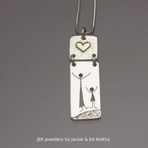 "An image of a piece of Jewellery ,a double hinged pendant with the title ""Mother And Child"", in sterling silver with 9ct Gold by JEK Jewellery."