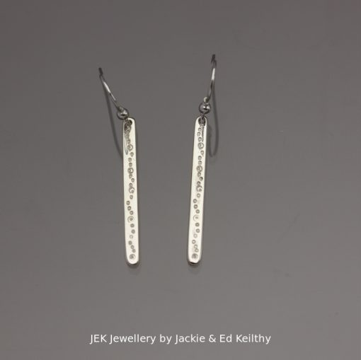 """An image of a piece of Jewellery a pair of simple stick earrings with the title """"Stick earrings with seeds/bubbles"""", in sterling silver by JEK Jewellery."""