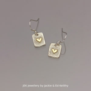 "An image of a piece of Jewellery with the title ""Heart Of Gold"" in sterling silver with 9ct Gold by JEK Jewellery."