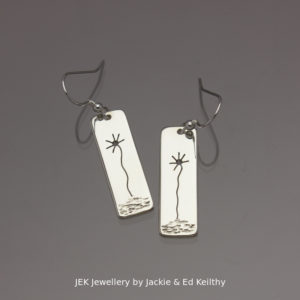 "An image of a piece of Jewellery.A pair of rectangular drop with the title "" Sunflowers""in sterling silver by JEK Jewellery."