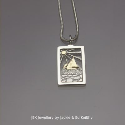"An image of a piece of Jewellery ,a rectangular framed pendant,with the title ""Galway Bay""in sterling silver with 9ct Gold by JEK Jewellery."