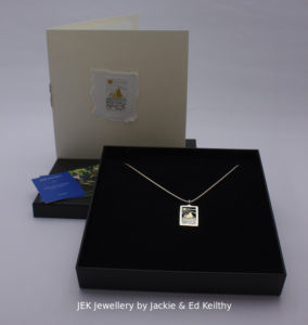 "An image of the piece title ""Galway Bay"" in its box and the hand drawn card that accompanies it and some jek business cards."