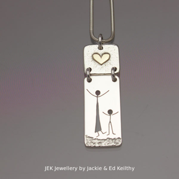 "An image of a piece of Jewellery ,a double hinged pendant with the title ""Mother And Child"", in sterling silver with 9ct Gold by JEK Jewellery"