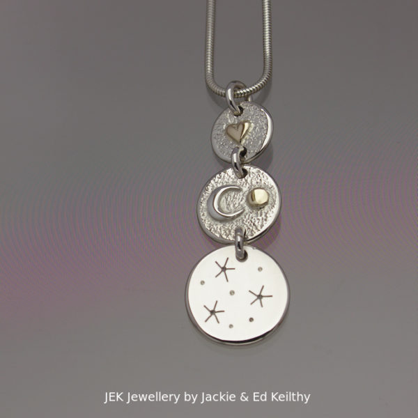 "An image of a piece of Jewellery ,a triple hinged pendant with the title ""You Are My Sun,Moon And Stars"" in sterling silver with 9ct Gold by JEK Jewellery."