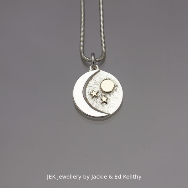 "An image of a piece of Jewellery ,a round. pendant with the title ""What You Mean To Me""in sterling silver with 9ct Gold by JEK Jewellery."