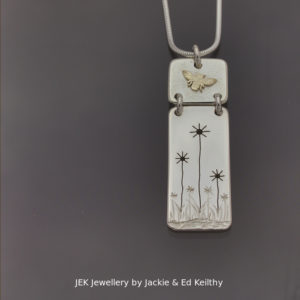 "An image of a piece of Jewellery .A double hinged pendant with the title ""Harmony"" in sterling silver with 9ct Gold by JEK Jewellery."
