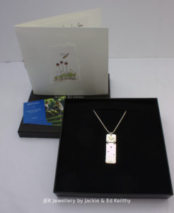 """An image of the piece of jewellery called """"Harmony"""" with the packaging that goes with the piece"""